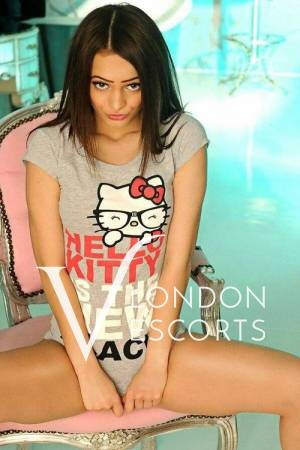 Kandy on pink chair in hello kitty shirt