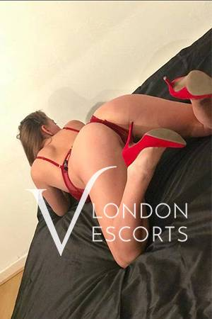 Jess bent over in a red thong