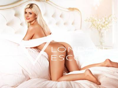 Ella in white scarf posing seductively on a bed